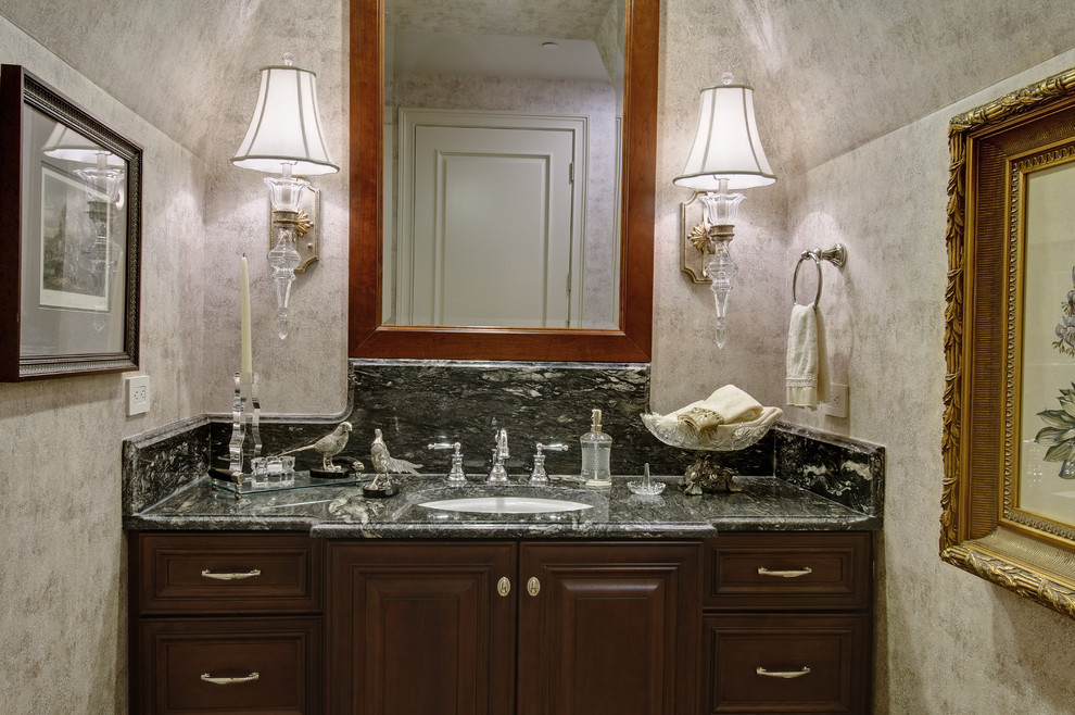 Inspiration for a timeless bathroom remodel in Columbus with an undermount sink, raised-panel cabinets and dark wood cabinets