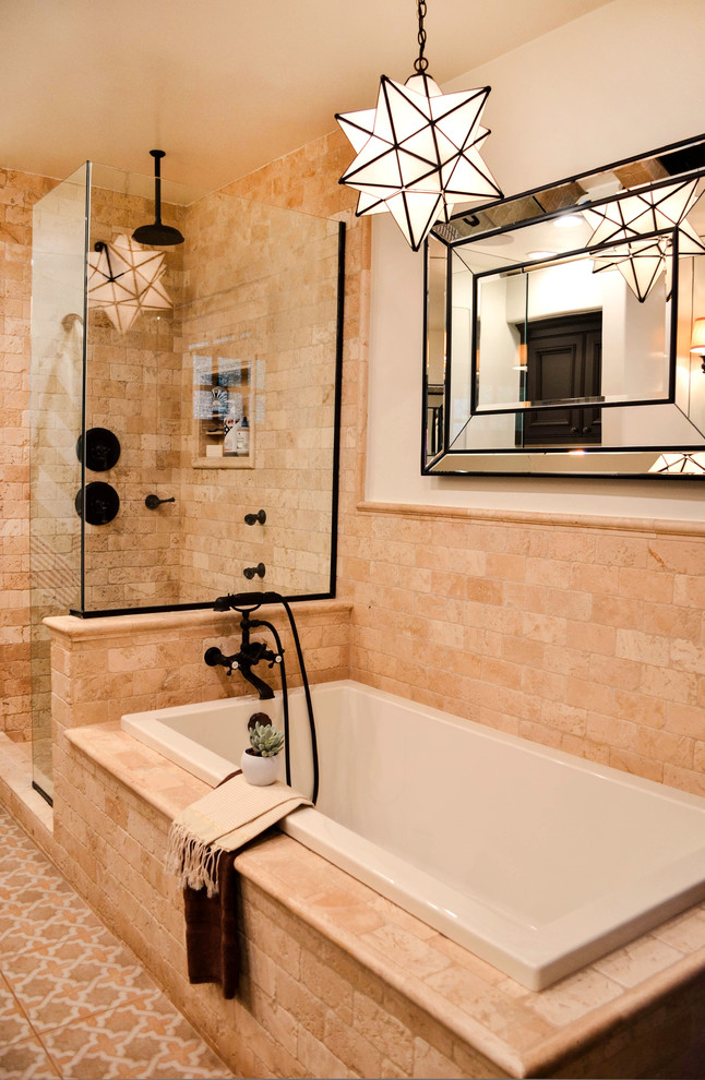 Inspiration for a mid-sized mediterranean master beige tile and travertine tile porcelain tile and multicolored floor bathroom remodel in Los Angeles with beaded inset cabinets, brown cabinets, a one-piece toilet, white walls, an undermount sink, solid surface countertops, a hinged shower door and gray countertops