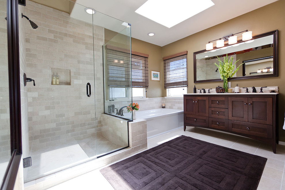 Inspiration for a large timeless master beige tile and porcelain tile bathroom remodel in Los Angeles with shaker cabinets, dark wood cabinets, an undermount sink and brown walls