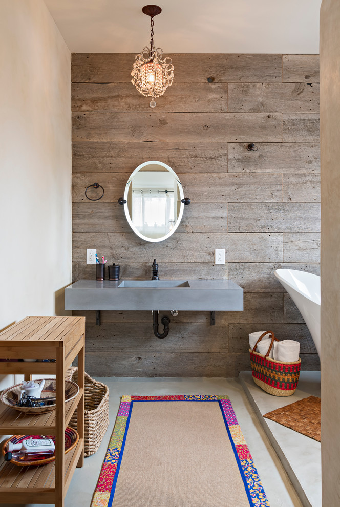 Example of a mid-sized southwest master gray floor bathroom design in Denver with brown walls, an undermount sink, concrete countertops and gray countertops