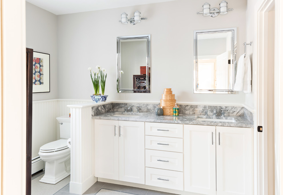 Bathroom - traditional bathroom idea in Boston with an undermount sink, shaker cabinets, white cabinets, a two-piece toilet and gray walls