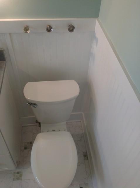 Repurposed Door Knobs As Towel Holders In A Cottage Style