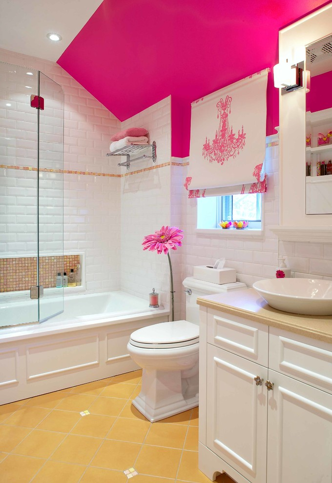Elegant kids' white tile and subway tile yellow floor bathroom photo in Montreal with a vessel sink, recessed-panel cabinets, white cabinets, a two-piece toilet and pink walls