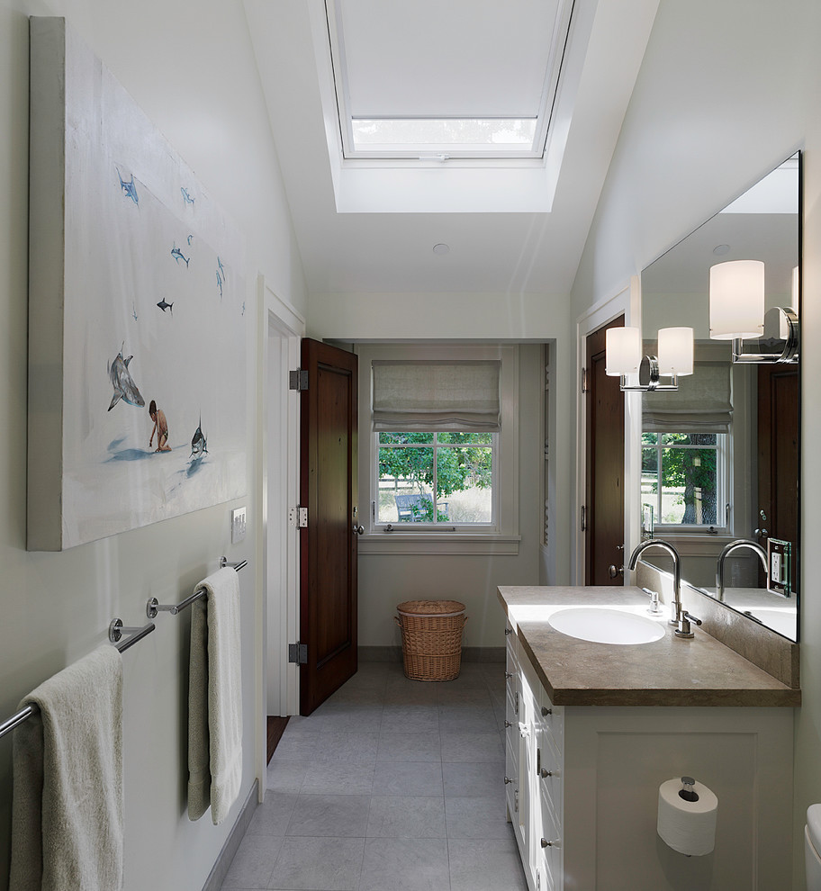 Example of a classic master gray tile limestone floor bathroom design in San Francisco with an undermount sink, flat-panel cabinets and white cabinets