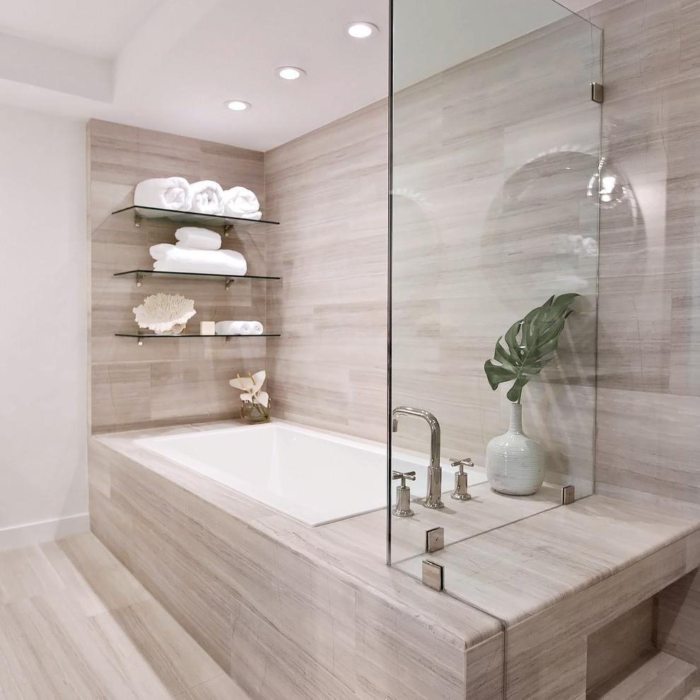 Drop-in bathtub - contemporary beige floor drop-in bathtub idea in Miami with beige walls