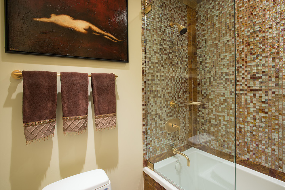 Mid-sized tuscan 3/4 beige tile, brown tile, multicolored tile, white tile and mosaic tile ceramic tile bathroom photo in Los Angeles with flat-panel cabinets, medium tone wood cabinets, brown walls, granite countertops and a two-piece toilet