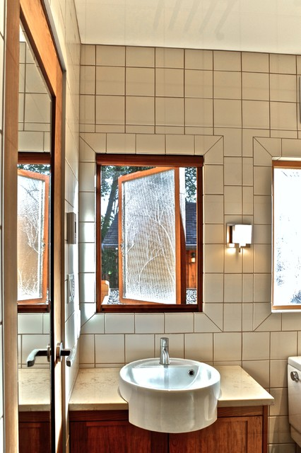 Retractable insect screens at seaside cottage, BC traditional