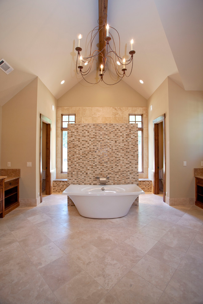 Huge mountain style master beige tile, brown tile, white tile and matchstick tile travertine floor and beige floor bathroom photo in Atlanta with raised-panel cabinets, light wood cabinets, beige walls, granite countertops and a hinged shower door