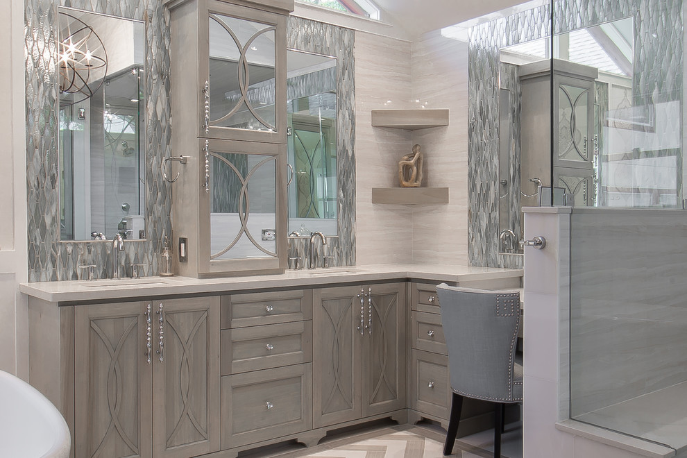Inspiration for a mid-sized transitional master gray tile and porcelain tile porcelain floor bathroom remodel in Houston with an undermount sink, furniture-like cabinets, gray cabinets, quartzite countertops, a two-piece toilet and gray walls