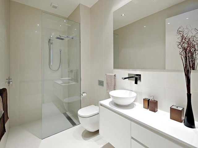 Inspiration for a mid-sized modern 3/4 porcelain tile and white tile porcelain floor bathroom remodel in Melbourne with flat-panel cabinets, white cabinets, engineered quartz countertops, a wall-mount toilet, white walls and a vessel sink