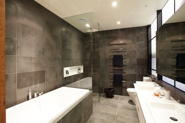 Urban gray tile bathroom photo in Melbourne with a drop-in sink, white cabinets