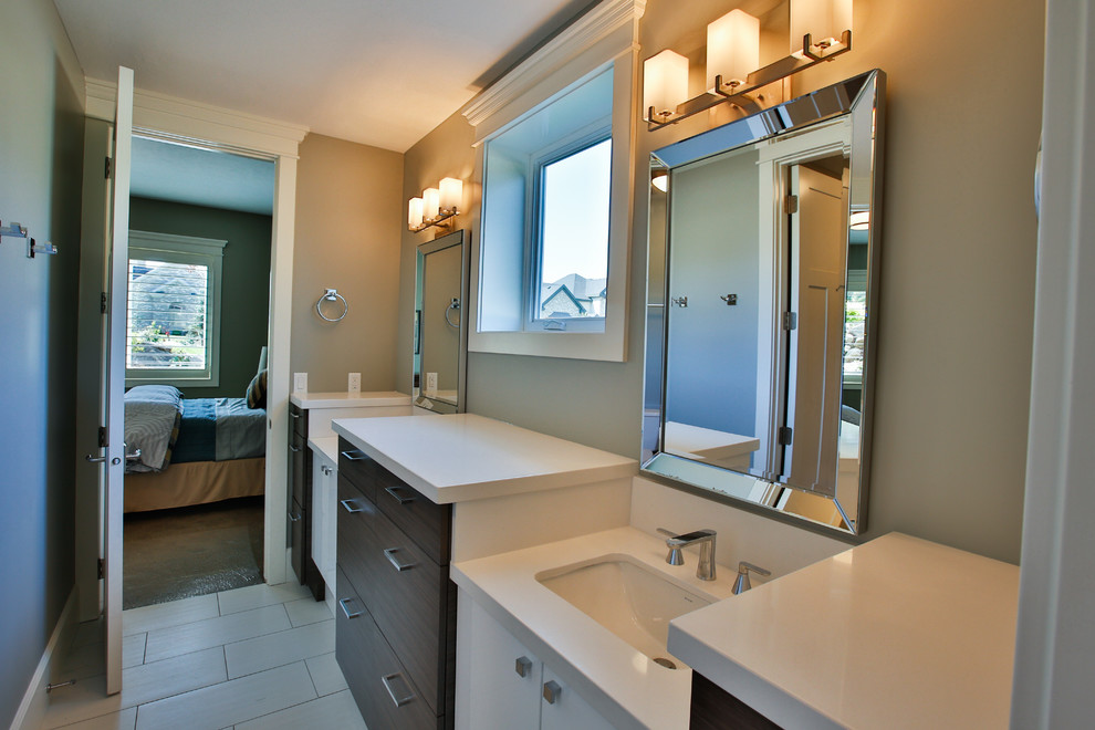 Tub/shower combo - large transitional kids' gray tile and porcelain tile porcelain tile tub/shower combo idea in Salt Lake City with an undermount sink, flat-panel cabinets, white cabinets, gray walls, quartzite countertops and an undermount tub