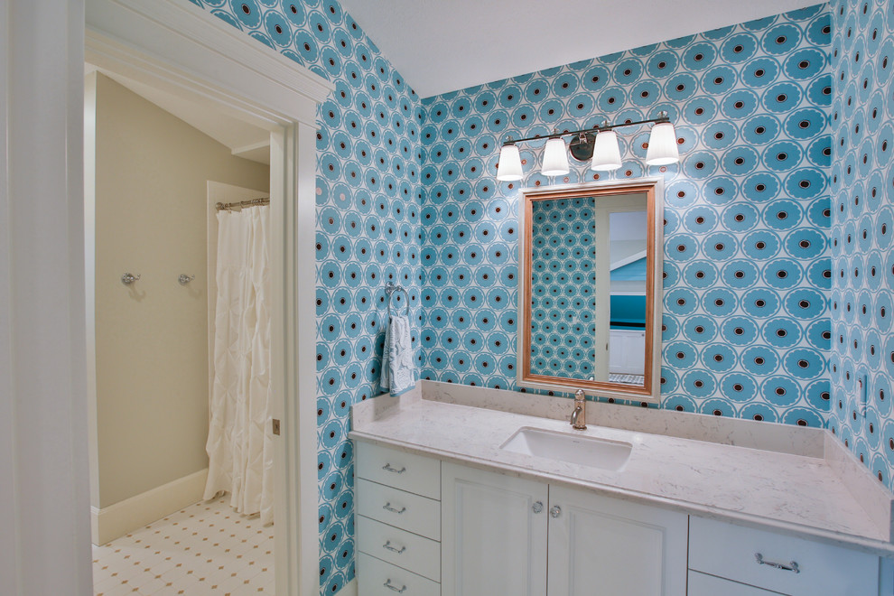 Bathroom - large transitional kids' white tile mosaic tile floor bathroom idea in Salt Lake City with an undermount sink, recessed-panel cabinets, white cabinets, blue walls and quartzite countertops