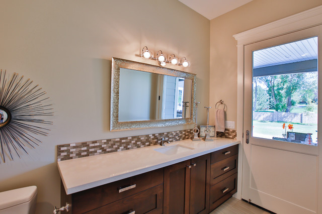 Large transitional 3/4 multicolored tile and glass tile porcelain floor tub/shower combo photo in Salt Lake City with an undermount sink, shaker cabinets, dark wood cabinets, beige walls, quartzite countertops and an undermount tub