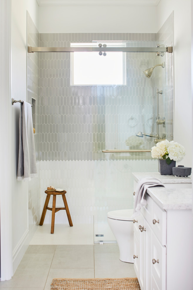 Bathroom - transitional gray tile gray floor and single-sink bathroom idea in Other with shaker cabinets, white cabinets, white walls, an undermount sink, white countertops, a niche and a built-in vanity