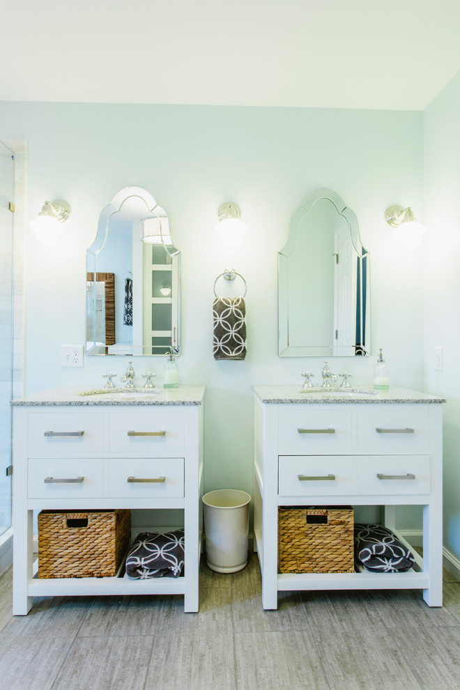 Bathroom - traditional bathroom idea in Nashville with an undermount sink, white cabinets and flat-panel cabinets