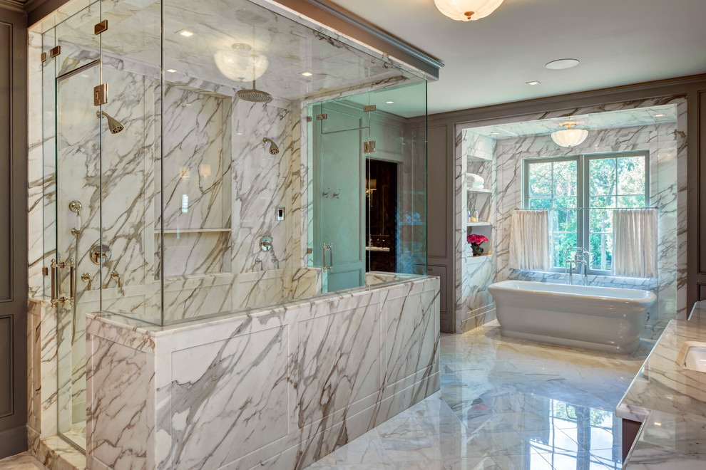 Bathroom - traditional master marble tile marble floor and white floor bathroom idea in Houston with gray walls, an undermount sink, marble countertops and a hinged shower door