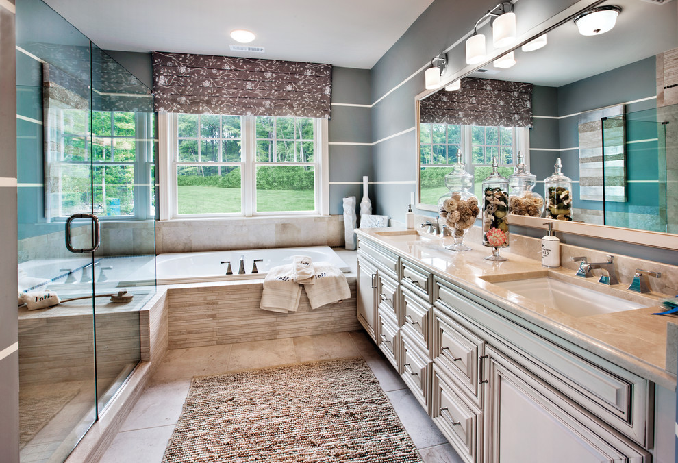 Example of a transitional beige tile bathroom design in Chicago with an undermount sink, raised-panel cabinets and beige cabinets