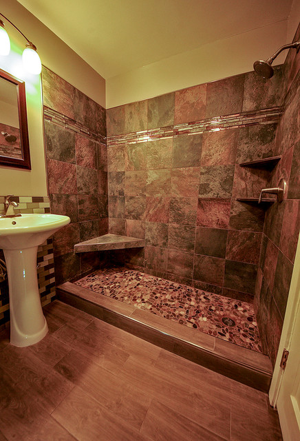River rock shower floor bathroom remodel for Granite and tile bathroom ideas