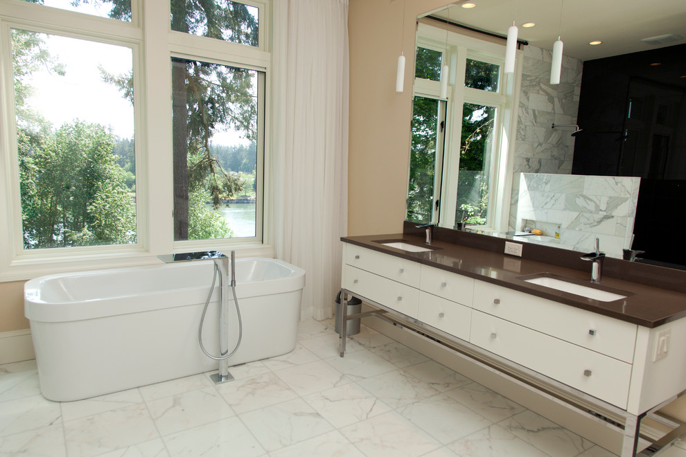 Large trendy master gray tile and marble tile marble floor and white floor bathroom photo in Portland with flat-panel cabinets, white cabinets, beige walls, an undermount sink and quartz countertops