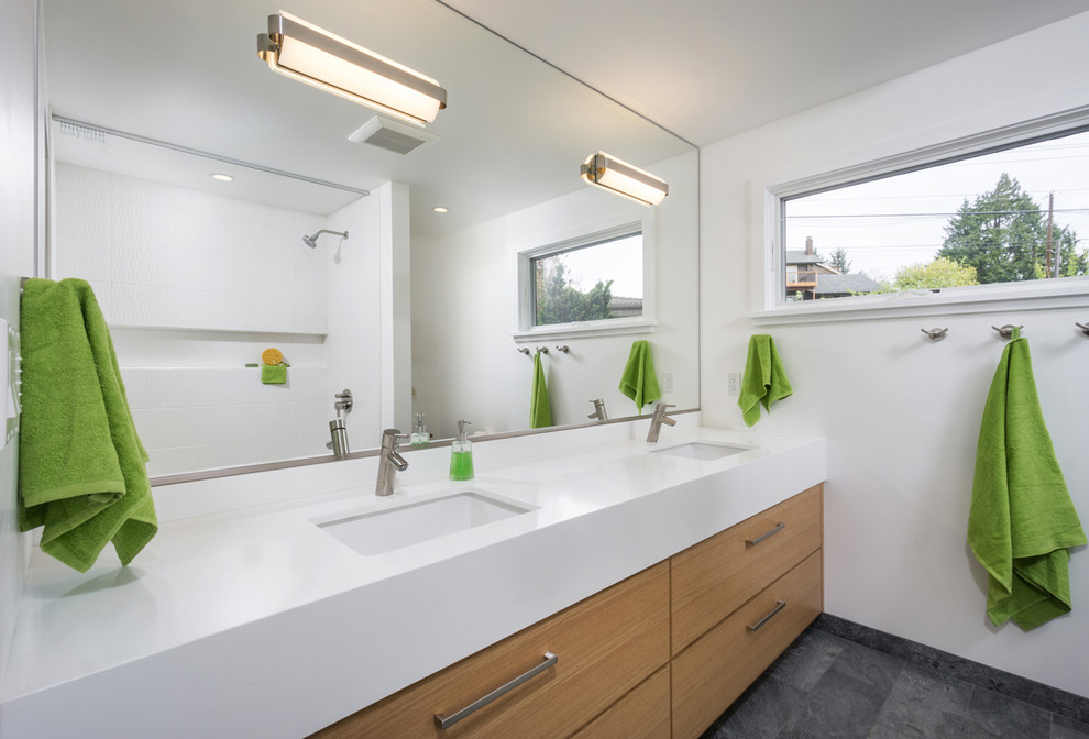 Example of a mid-sized trendy kids' white tile bathroom design in Portland with flat-panel cabinets, medium tone wood cabinets, quartz countertops, an undermount sink, white walls and white countertops