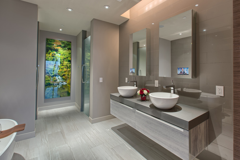 Large minimalist master porcelain tile and gray floor bathroom photo in Other with flat-panel cabinets, gray cabinets, gray walls, a vessel sink, a hinged shower door and gray countertops