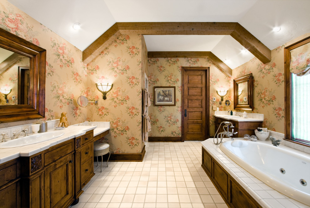 Drop-in bathtub - country white tile drop-in bathtub idea in Chicago with a drop-in sink, furniture-like cabinets, dark wood cabinets and tile countertops