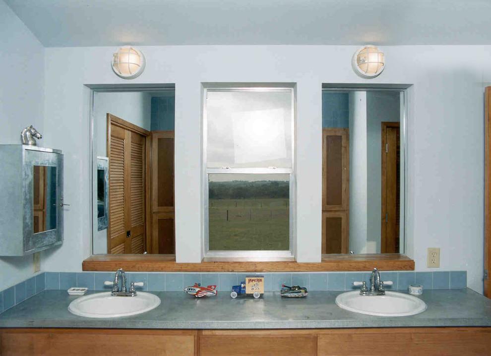 Bathroom - industrial bathroom idea in Austin