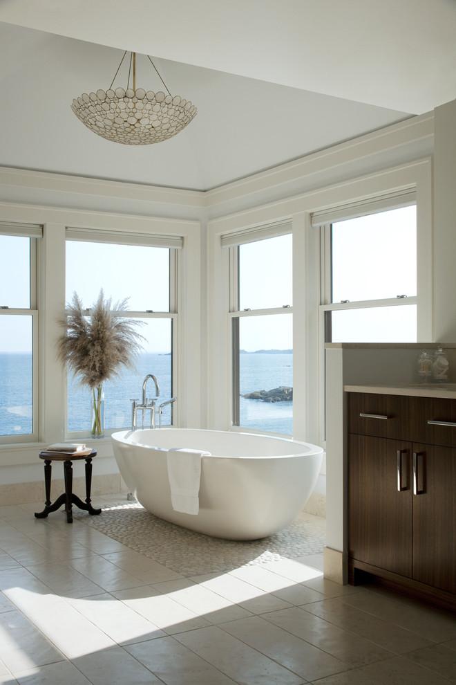 Transitional pebble tile floor freestanding bathtub photo in Boston