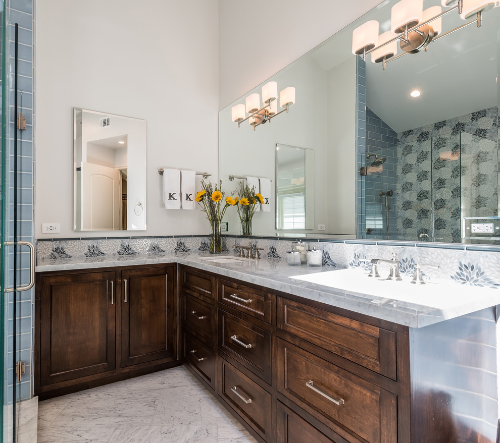 Example of a large transitional master blue tile and mosaic tile marble floor and white floor bathroom design in Los Angeles with raised-panel cabinets, dark wood cabinets, a one-piece toilet, gray walls, a drop-in sink, marble countertops, a hinged shower door and white countertops
