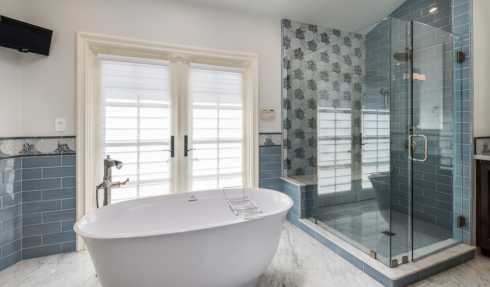 Large transitional master blue tile and mosaic tile marble floor and white floor bathroom photo in Los Angeles with raised-panel cabinets, dark wood cabinets, a one-piece toilet, gray walls, a drop-in sink, marble countertops, a hinged shower door and white countertops