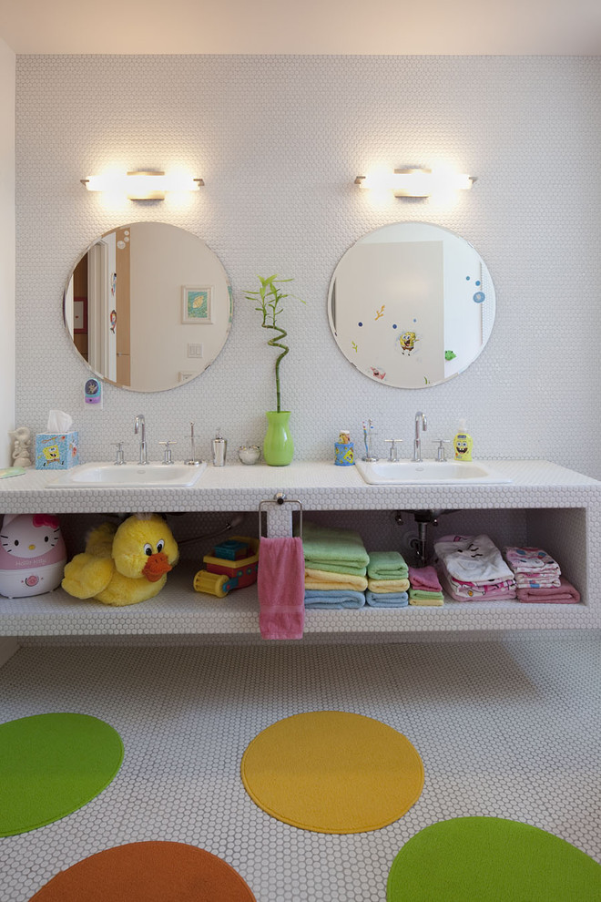 Example of a mid-sized trendy kids' mosaic tile and white tile mosaic tile floor bathroom design in Austin with tile countertops, open cabinets, white cabinets, white walls and a drop-in sink