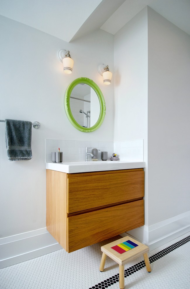 Bathroom - mid-sized contemporary kids' white tile and mosaic tile mosaic tile floor and white floor bathroom idea in Toronto with flat-panel cabinets, medium tone wood cabinets, solid surface countertops, white walls, a two-piece toilet, an undermount sink and white countertops