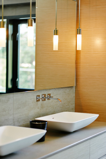 Mid-sized trendy master gray tile and porcelain tile porcelain floor bathroom photo in Vancouver with a vessel sink, flat-panel cabinets, light wood cabinets, engineered quartz countertops, a wall-mount toilet and gray walls