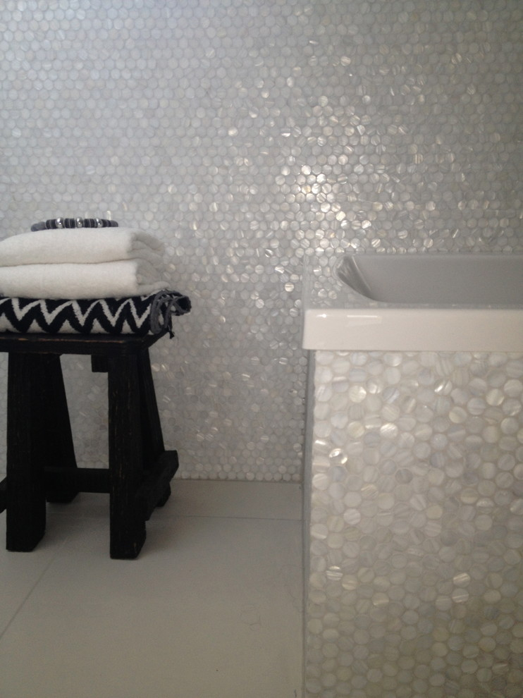 Inspiration for a contemporary white tile and mosaic tile bathroom remodel in Other