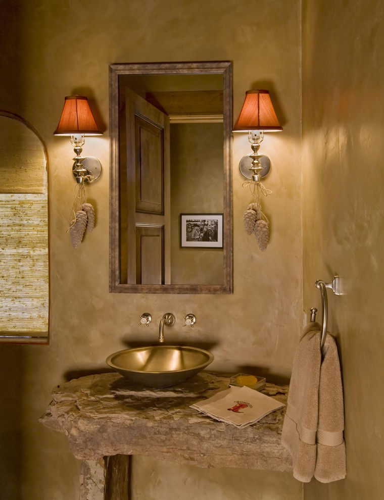 Inspiration for a rustic bathroom remodel in Other with a vessel sink
