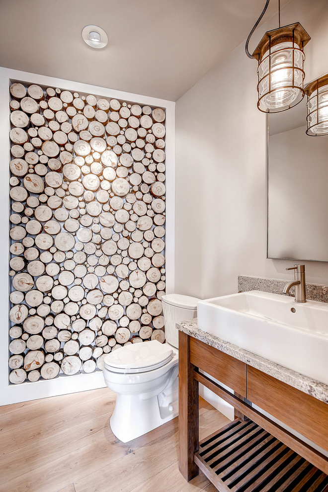Mountain style light wood floor bathroom photo in Denver with a vessel sink, medium tone wood cabinets, gray walls and gray countertops
