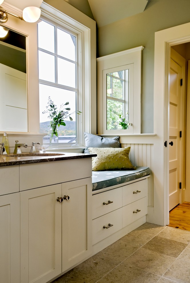 Bathroom - rustic bathroom idea in Burlington with an undermount sink, shaker cabinets and white cabinets
