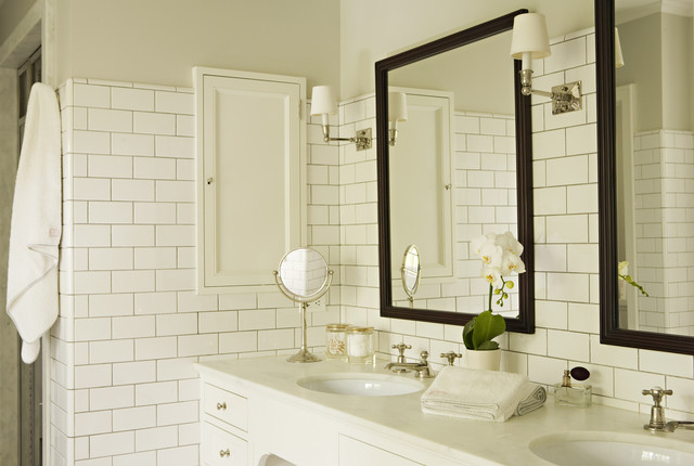 Elegant white tile and subway tile bathroom photo in Los Angeles with an  undermount sink and