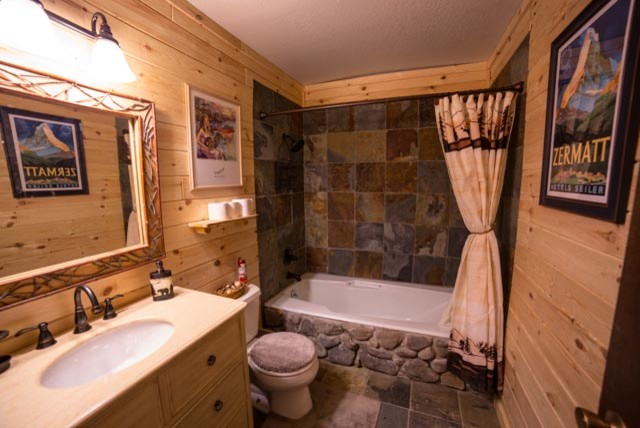 Rustic log cabin bathroom traditional bathroom other for Cabin shower tile ideas