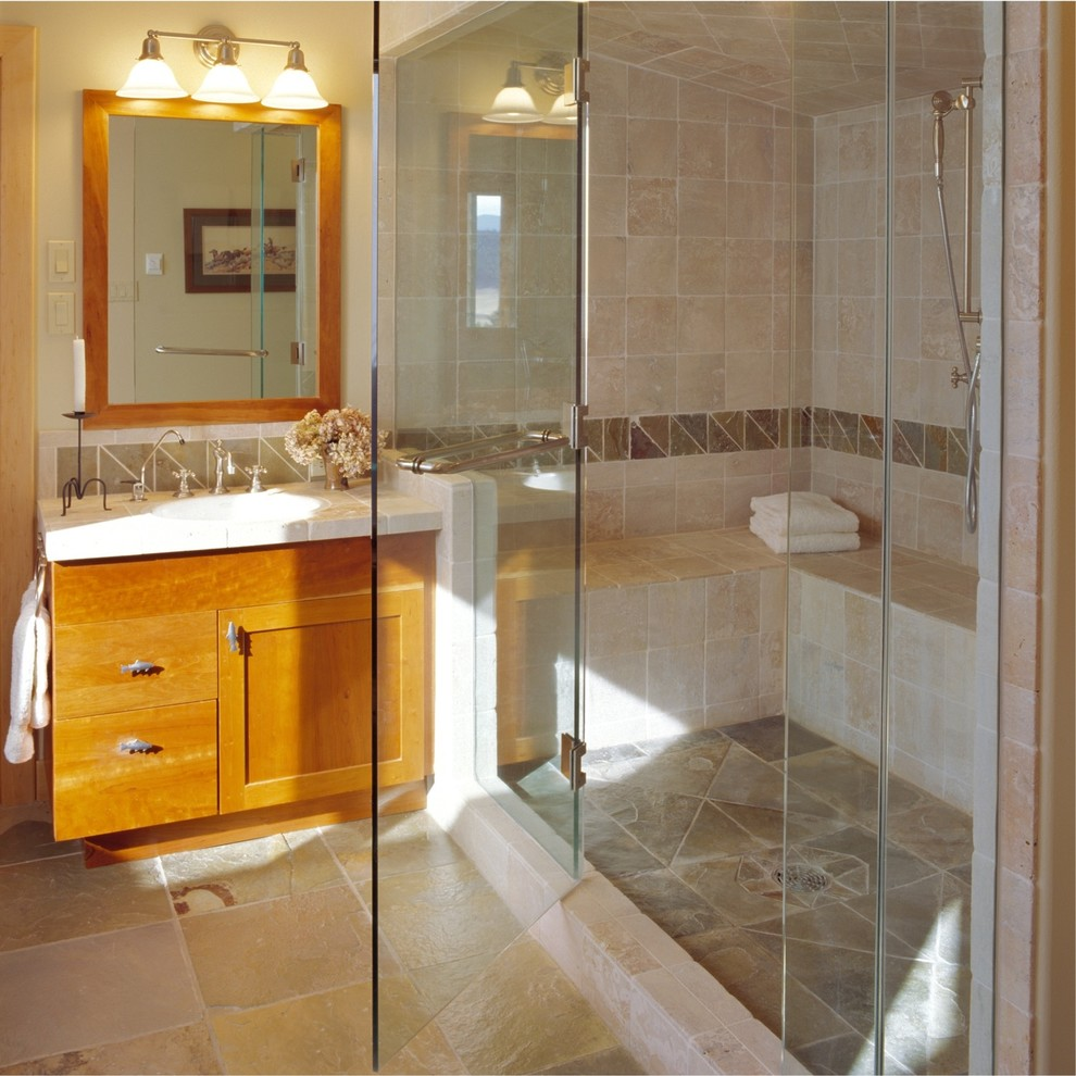 Mountain style beige tile alcove shower photo in Other with an undermount sink, shaker cabinets, medium tone wood cabinets and tile countertops