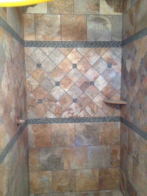 Rustic shower traditional bathroom other metro by for Rustic tile bathroom ideas