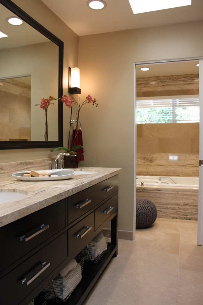 Example of a mid-sized transitional master beige tile and stone tile bathroom design in San Diego with an undermount sink, flat-panel cabinets, dark wood cabinets, a one-piece toilet and beige walls