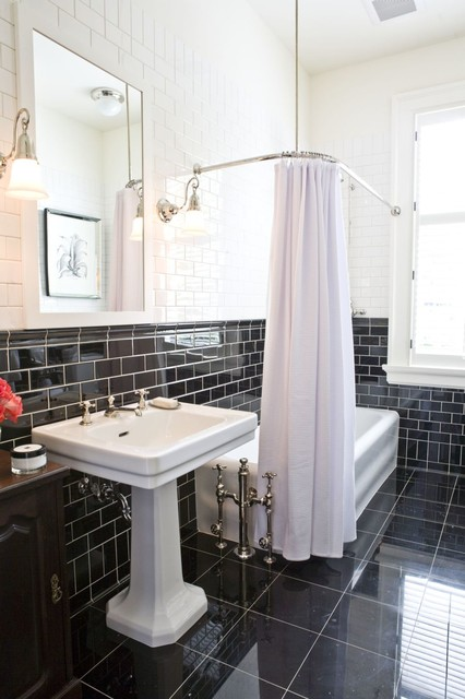 Inspiration for a timeless black tile and subway tile black floor tub/shower combo remodel in Calgary with a pedestal sink, furniture-like cabinets and dark wood cabinets