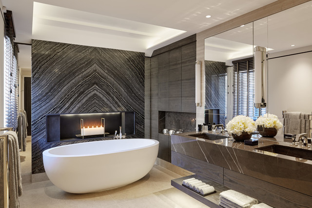 Inspiration for a contemporary freestanding bathtub remodel in London with an integrated sink
