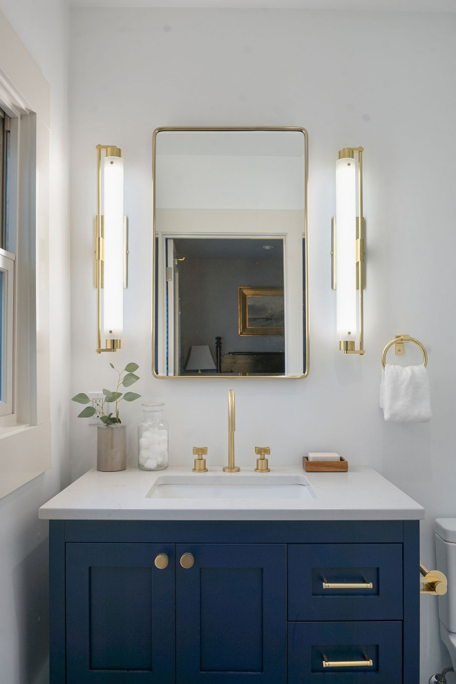 Small transitional master white tile and ceramic tile single-sink bathroom photo in San Francisco with shaker cabinets, blue cabinets, a two-piece toilet, white walls, an undermount sink, quartz countertops, gray countertops and a built-in vanity