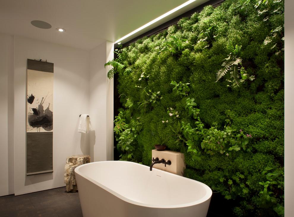 Freestanding bathtub - contemporary freestanding bathtub idea in San Francisco with green walls