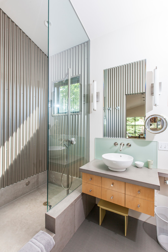 Example of a trendy metal tile bathroom design in San Francisco with a vessel sink, flat-panel cabinets and medium tone wood cabinets