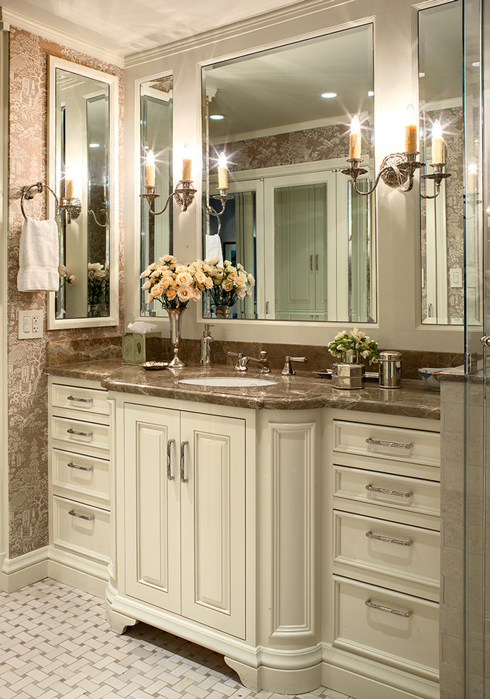 Elegant bathroom photo in San Francisco with an undermount sink, raised-panel cabinets and white cabinets