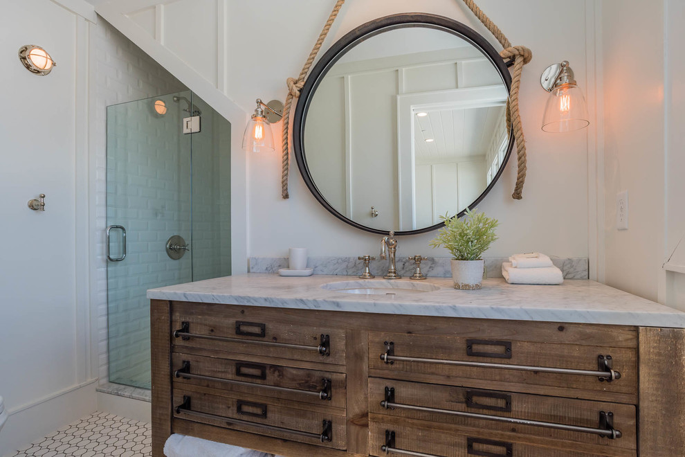 Example of a small beach style white tile and porcelain tile porcelain tile alcove shower design in Miami with furniture-like cabinets, medium tone wood cabinets, white walls, a console sink and marble countertops
